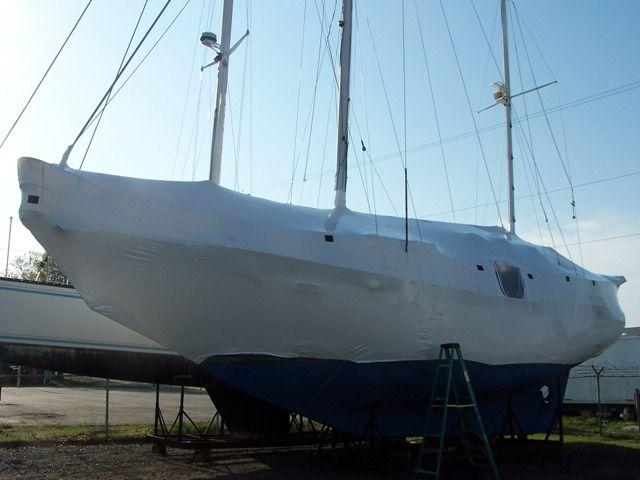 shrink wrapped sailboat mast up